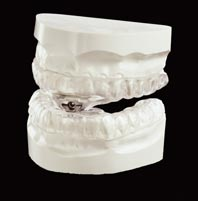 Dental treatments for snoring and apnoea can be a 'mono-block' or multi-part device.