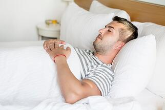 guy-sleeping-with-hands-on-his-chest_1169-35